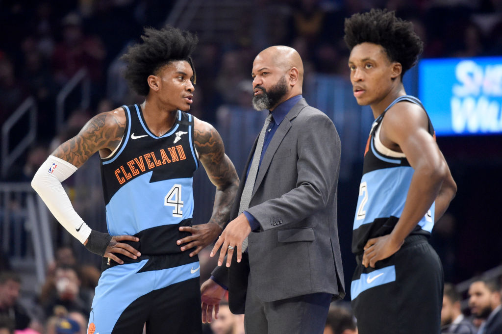 Cleveland Cavaliers head coach J.B. Bickerstaff talks to rookie Kevin Porter Jr. during a game.