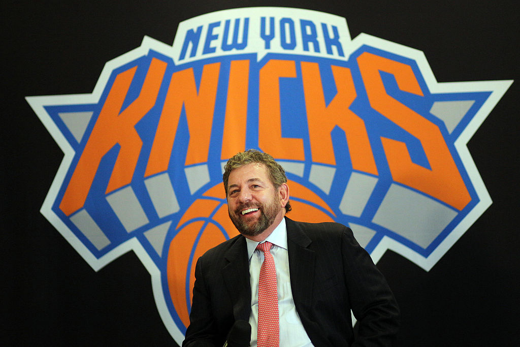 New York Knicks owner James Dolan sits in front of the Knicks logo at a press conference