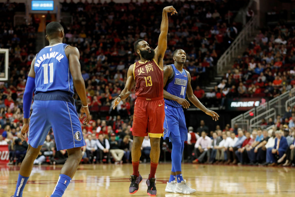 James Harden of the Houston Rockets defended by Dorian Finney-Smith of the Dallas Mavericks