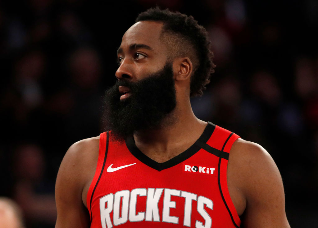 James Harden looks to the bench during a Rockets game