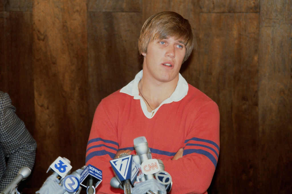 John Elway talks with the media after declaring he'll play for the Denver Broncos