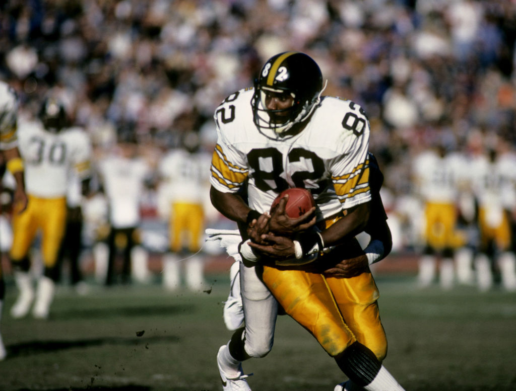 Pittsburgh Steelers wide receiver John Stallworth runs with the ball