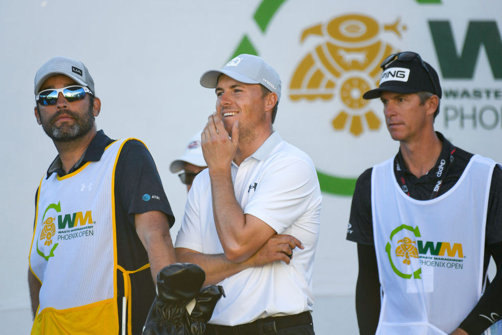 Jordan Spieth with his caddie Michael Greller and Bubba Watson's caddie Ted Scott at the Waste Management Phoenix Open in 2020