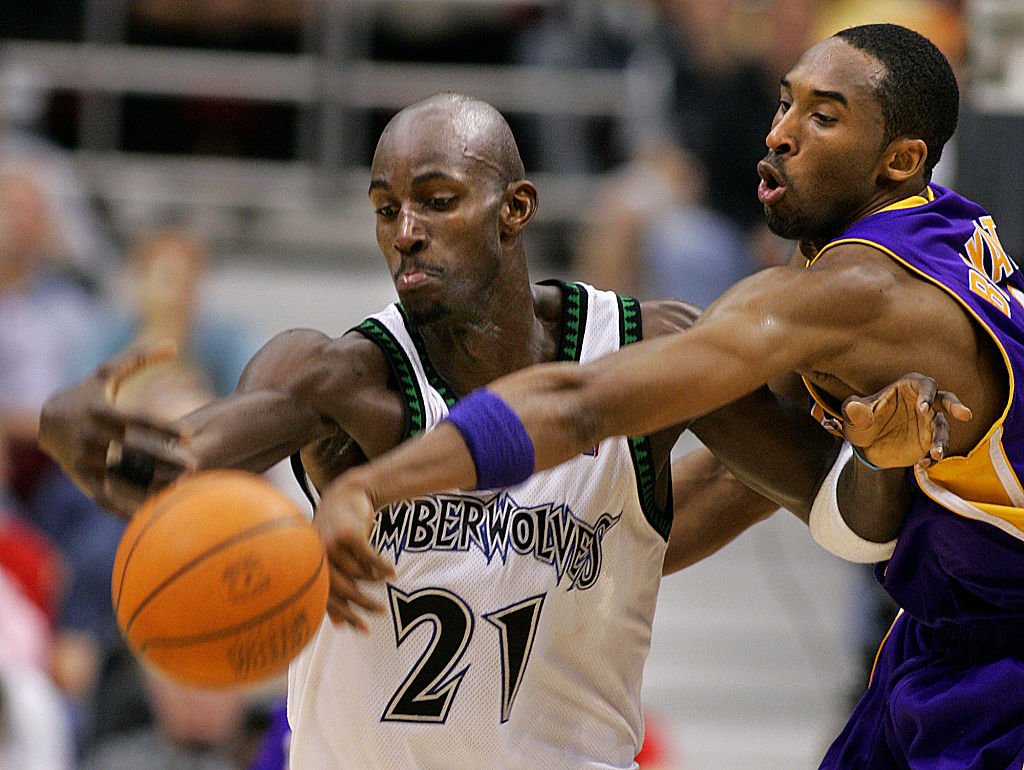 Kobe Bryant trying to steal the ball from Kevin Garnett