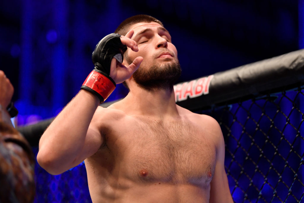 Khabib Nurmagomedov celebrates to himself after winning a UFC fight