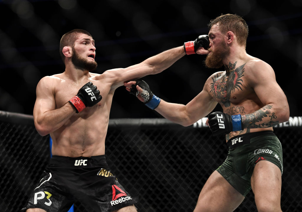 Khabib Nurmagomedov puniching Conor McGregor during a UFC fight