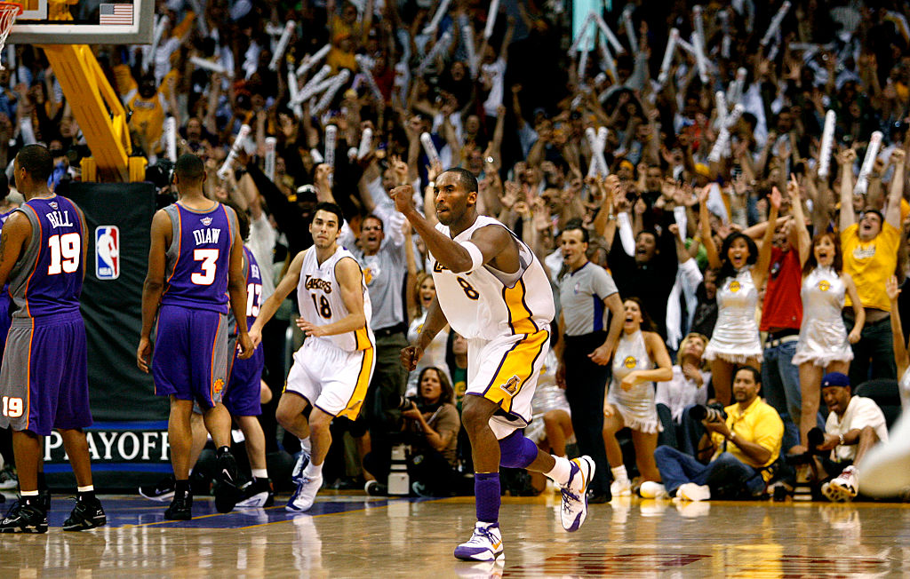 The Lakers' Kobe Bryant celebrates his game-winning shot in overtime against the Phoenix Suns in Game 4 of the 2006 Western Conference NBA Playoff