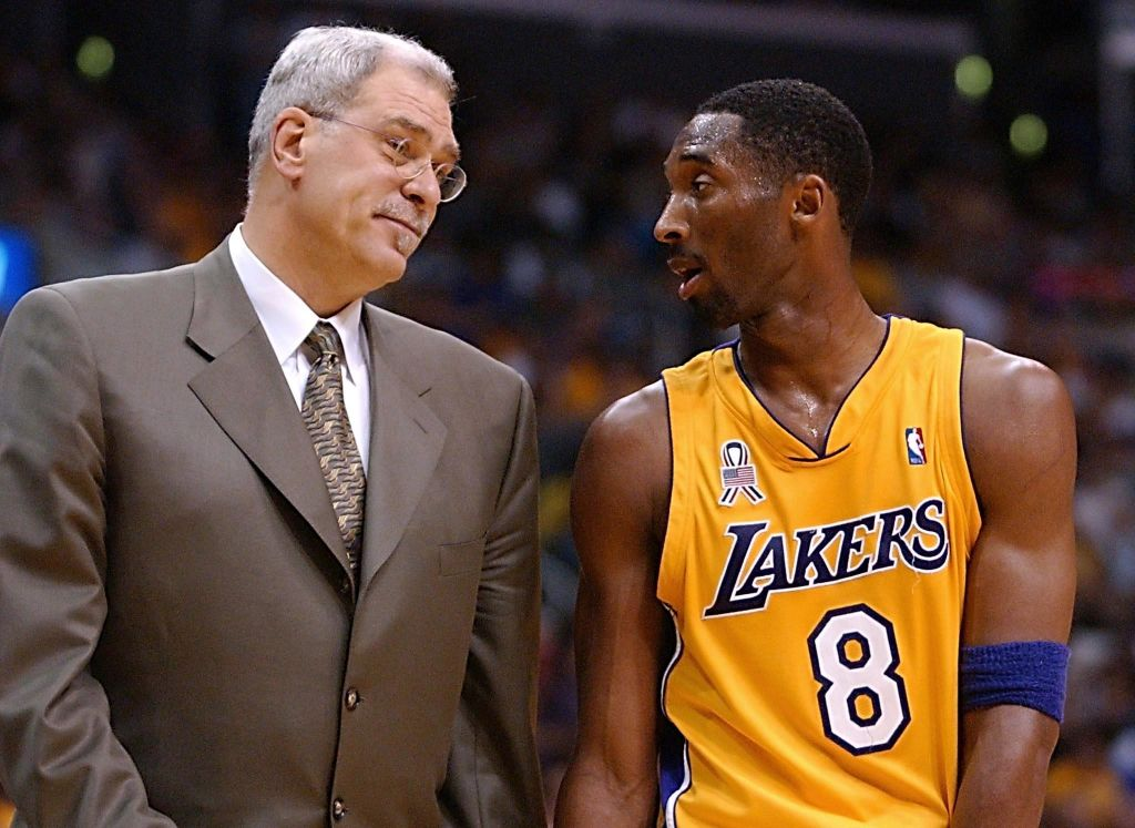 Phil Jackson talking to Kobe Bryant on the sideline during a game