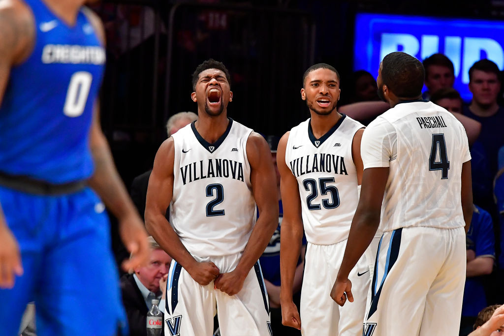 Kris Jenkins, Mikal Bridges, and Eric Paschall of the Villanova Wildcats celebrate a play