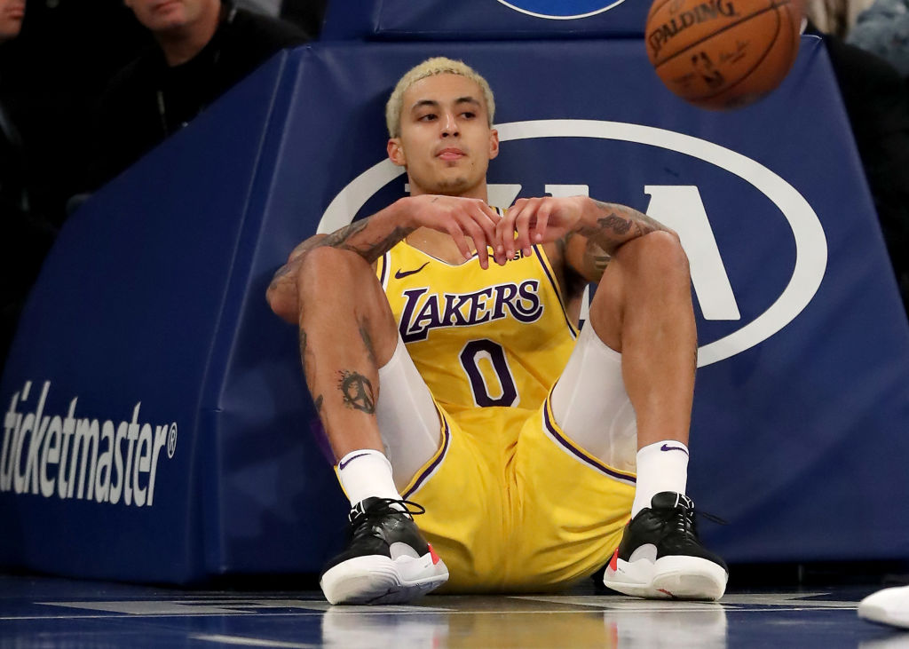 Kyle Kuzma of the Los Angeles Lakers sits on the court