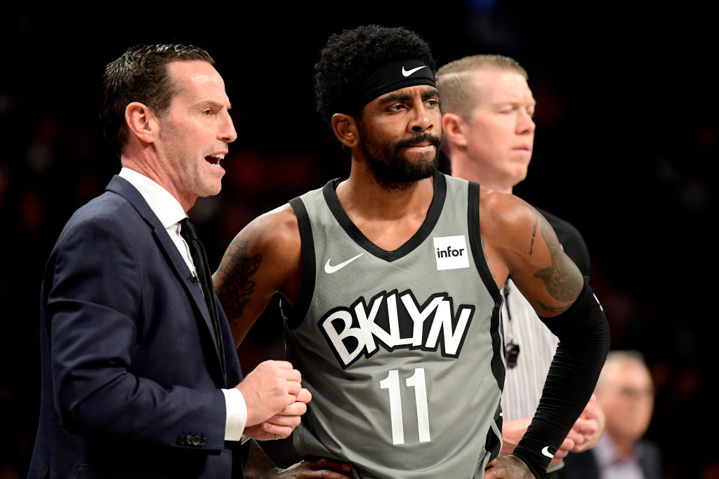 Kenny Atkinson talking to Kyrie Irving