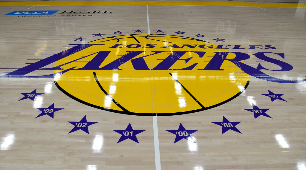 A Los Angeles Lakers logo on a basketball court