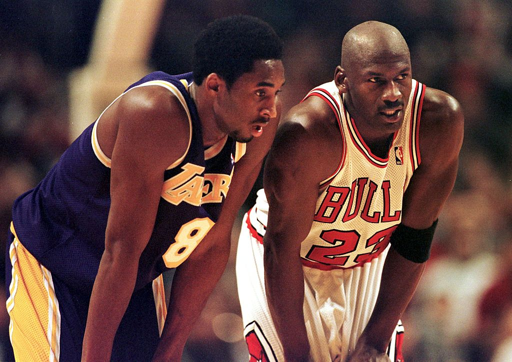 Los Angeles Lakers guard Kobe Bryant and Chicago Bulls guard Michael Jordan talk during a free-throw attempt