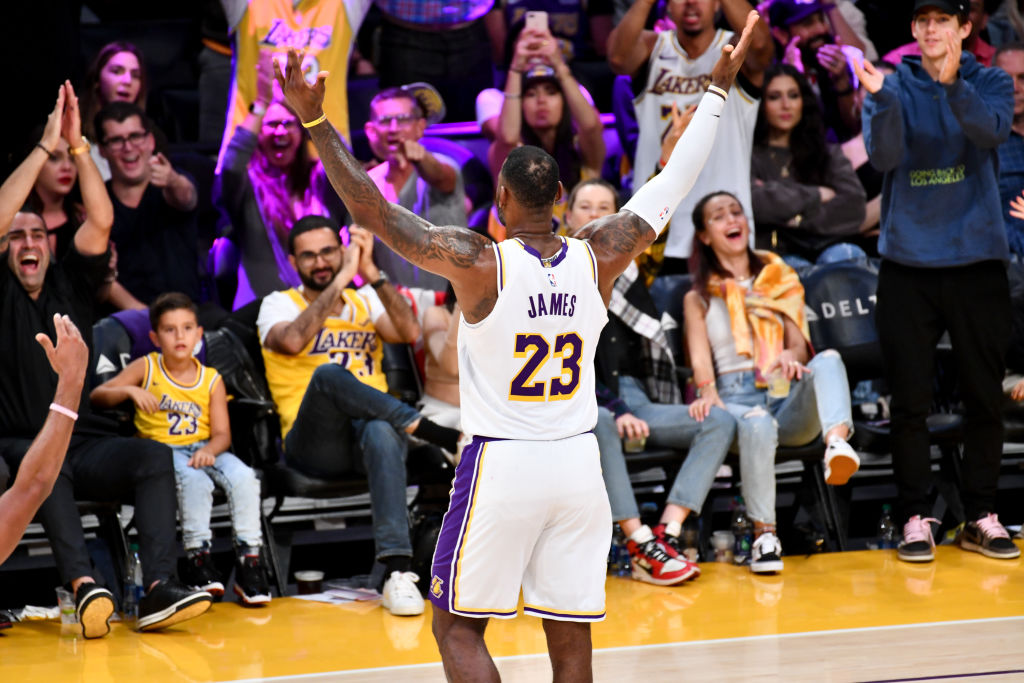 LeBron James celebrates with fans of the Los Angeles Lakers.