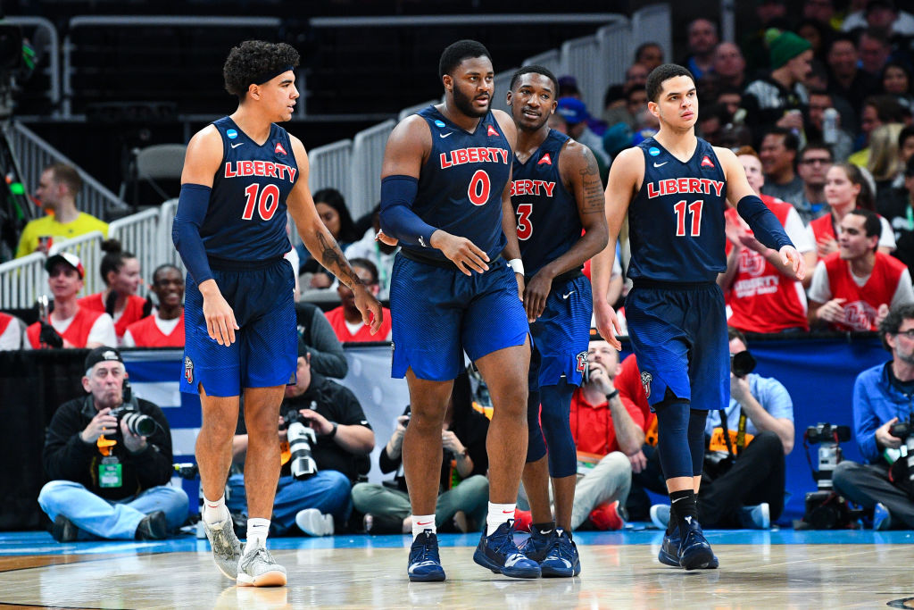 Elijah Cuffee (No. 10) and Myo Baxter-Bell (No. 0) are veteran players who could help Liberty be a storyline during March Madness.