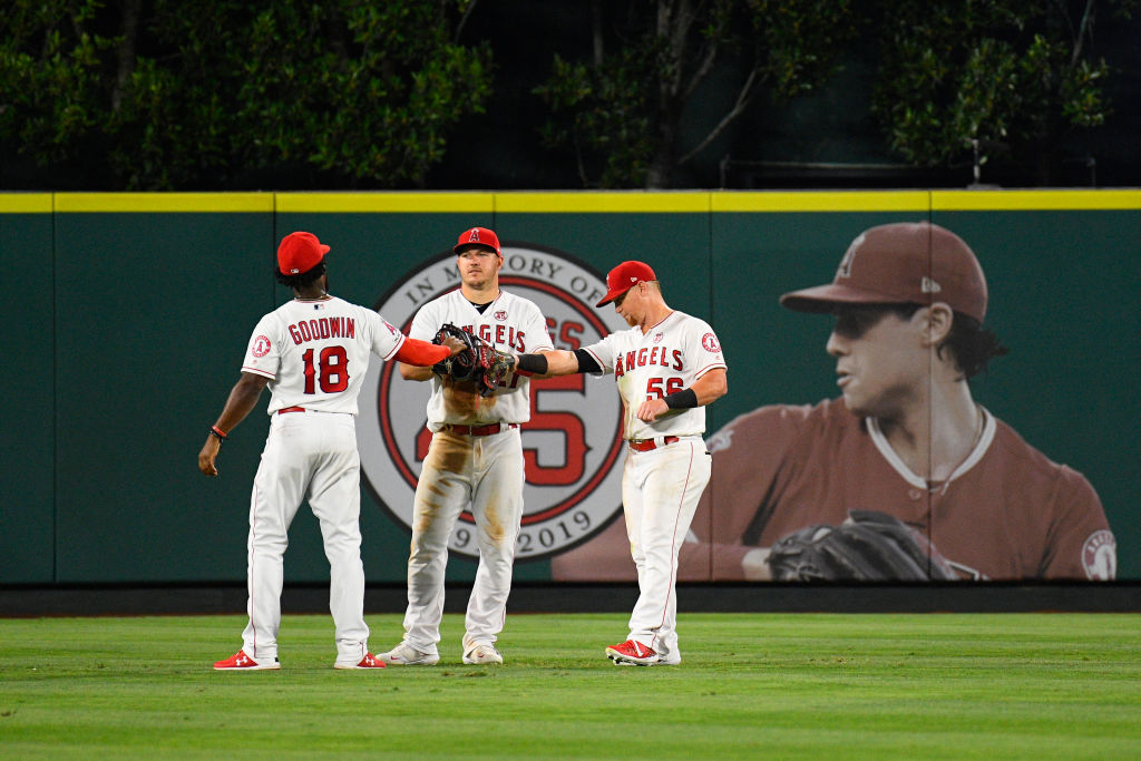 Los Angeles Angels Outfield Brian Goodwin, center fielder Mike Trout, and right fielder Kole Calhoun