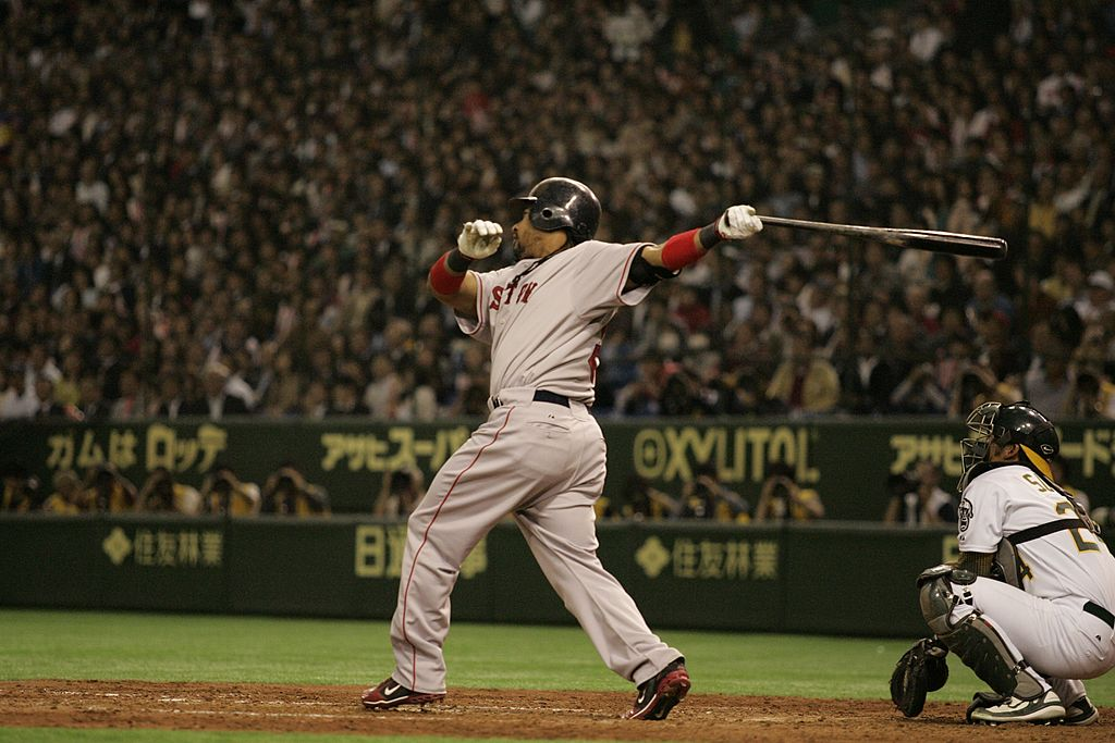 Boston Red Sox left fielder Manny Ramirez had four RBIs in Boston's 6-5 victory over Oakland on March 25, 2008. The game took place in Japan and marked the earliest opening day in MLB history.