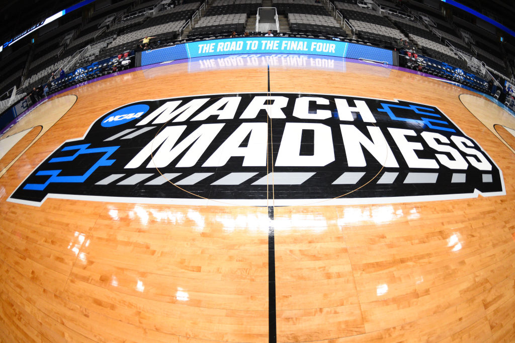 The March Madness logo on a basketball court
