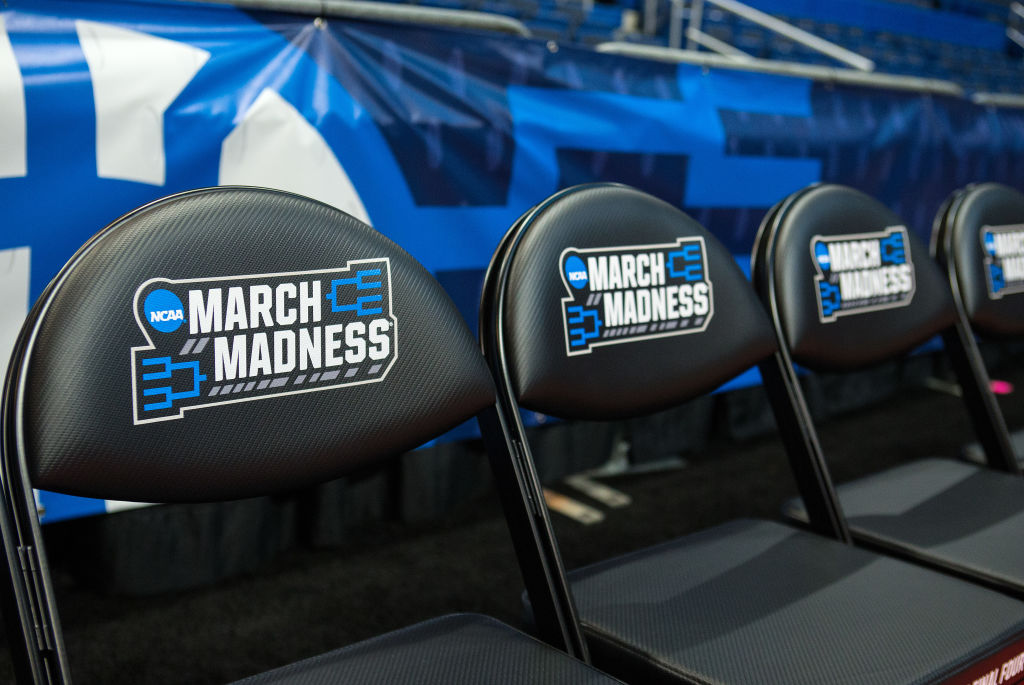 Black folding chairs with the March Madness logo on the chair backs