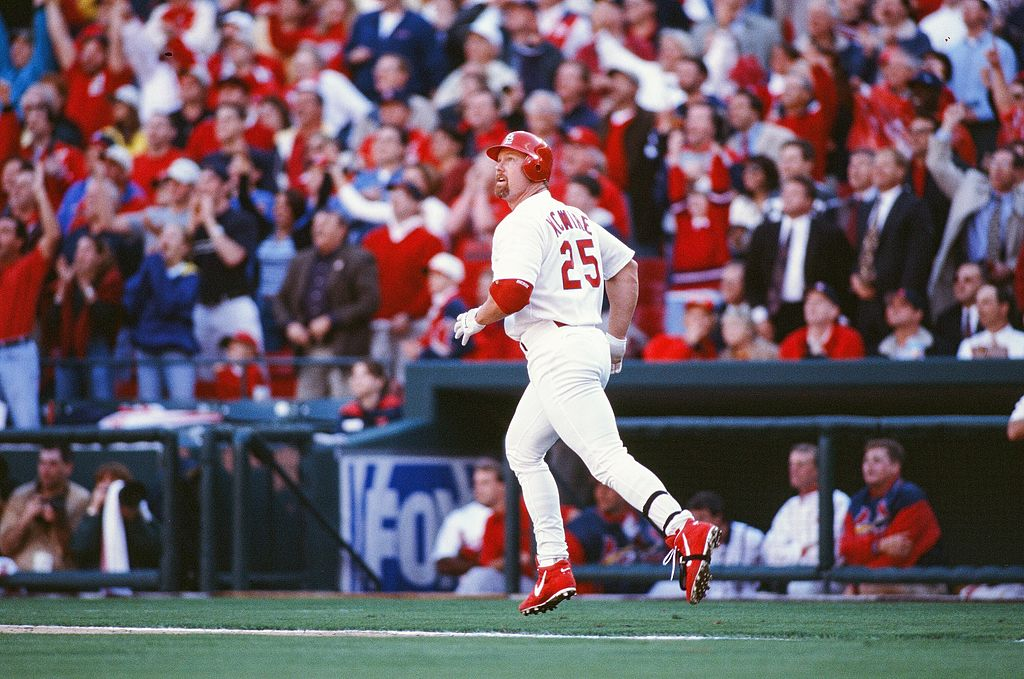 Every record needs to start somewhere. St. Louis Cardinals first baseman Mark McGwire hit the first of a record 70 home runs on March 31, 1998.