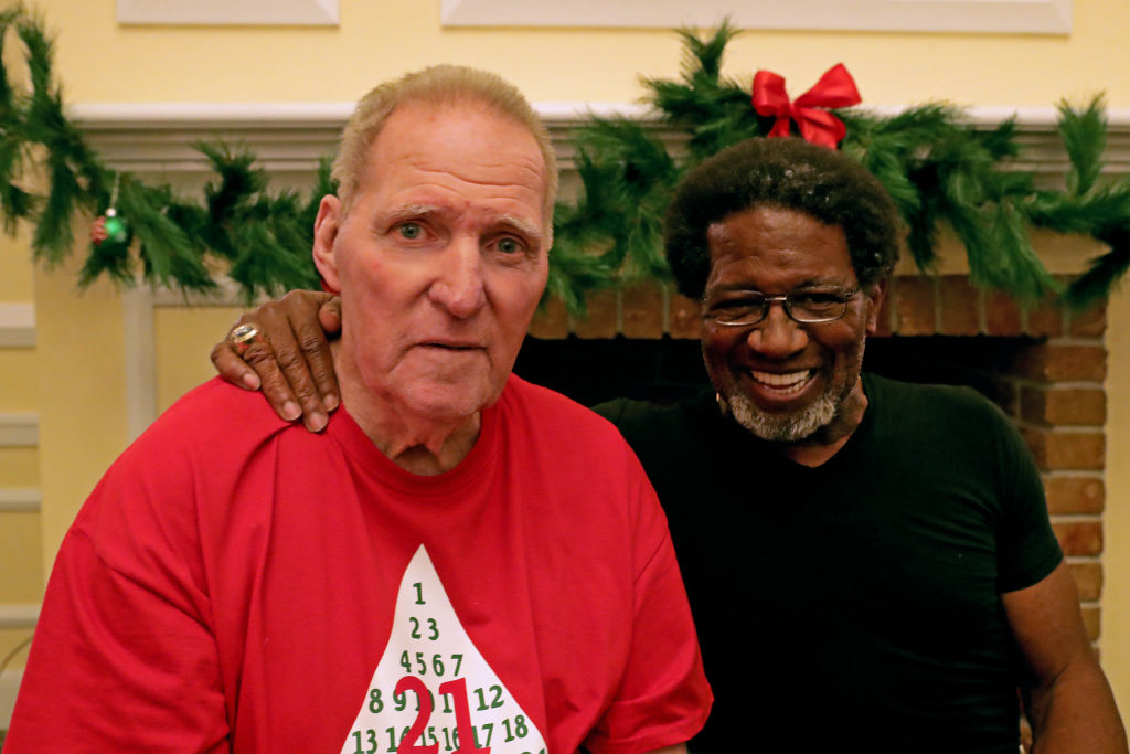 Former Miami Dolphins running backs Jim Kiick (L) and Mercury Morris smile at Independence Hall assisted living facility in 2018