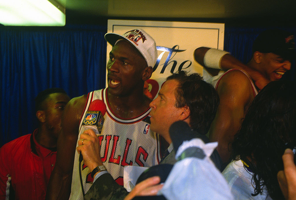 Michael Jordan of the Chicago Bulls talks with the media after defeating the Portland Trail Blazers in the 1992 NBA Finals.