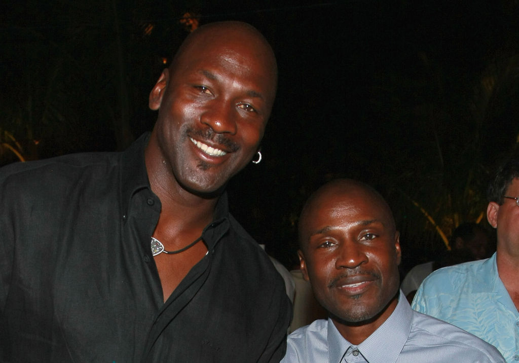 Michael Jordan poses from a photo with his brother Larry