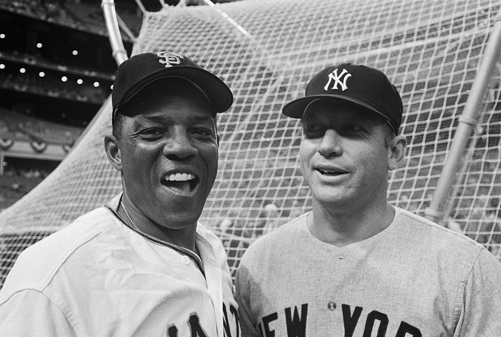 Mickey Mantle and Willie Mays posing together at an All-Star game