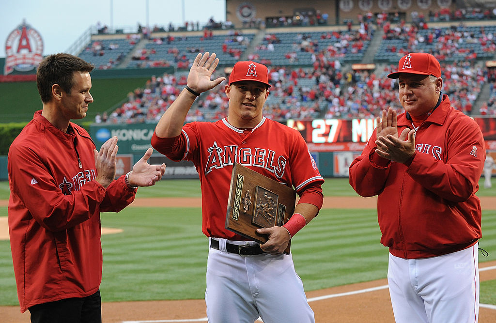 Mike Trout (C) of the Los Angeles Angels of Anaheim is presented with the Jackie Robinson Rookie of the Year Award in 2013