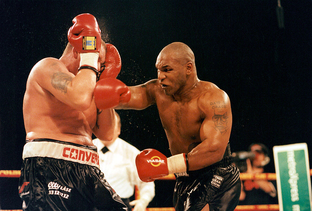 Mike Tyson throwing a punch during a boxing match