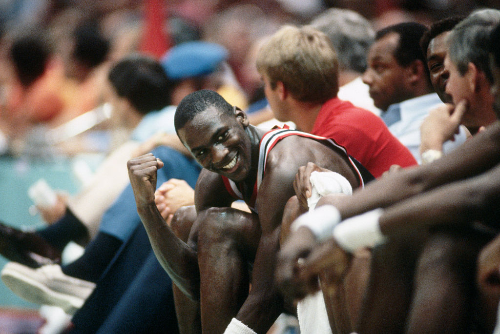 NBA player Michael Jordan sits on the bench during the 1984 Olympics