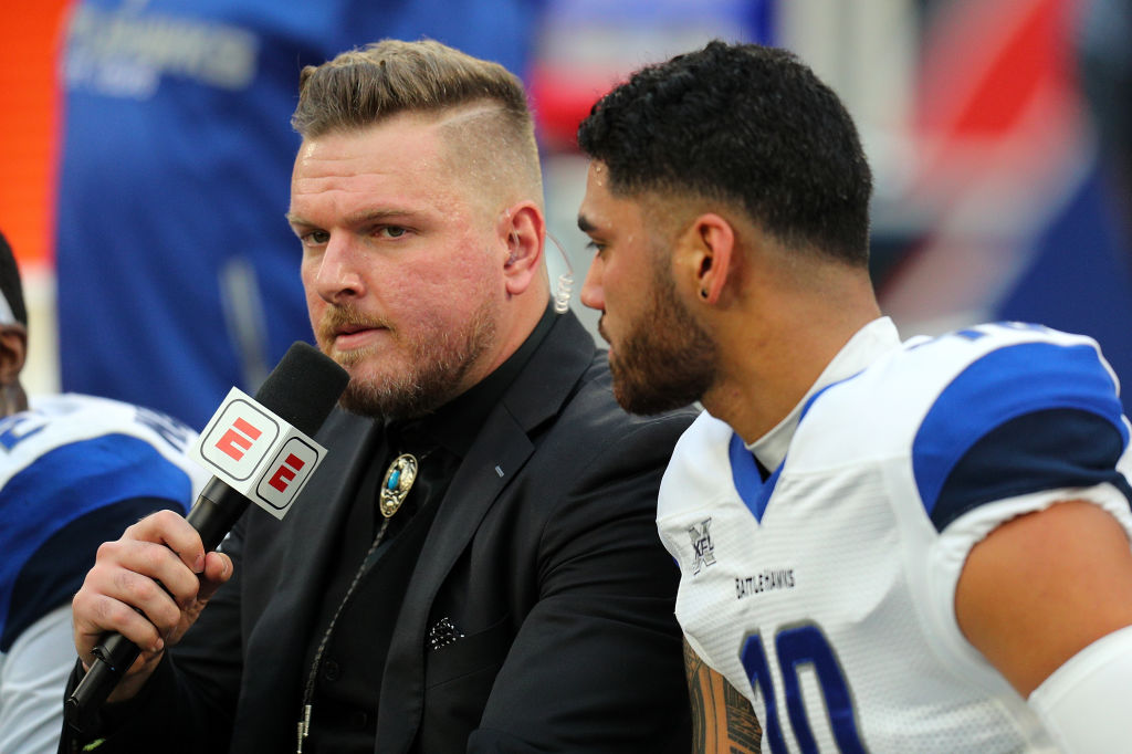 Pat McAfee interviews an XFL player on the sideline