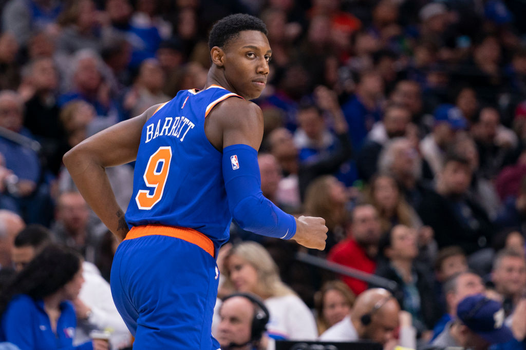 RJ Barrett of the New York Knicks looks on