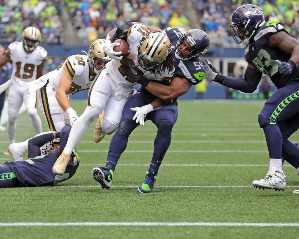 Seahawks middle linebacker Bobby Wagner tackles Saints running back Alvin Kamara