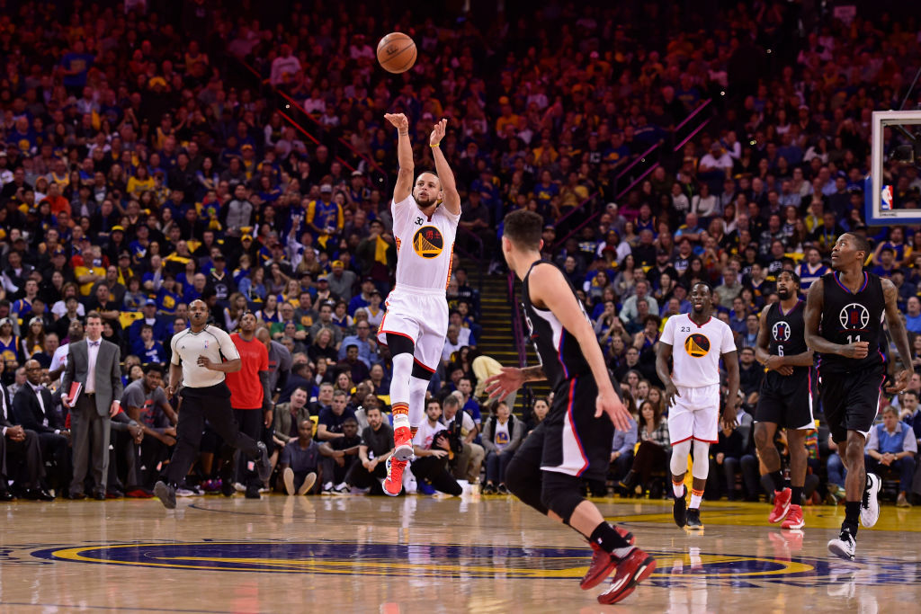 Golden State Warriors' Stephen Curry shoots and makes a half-court shot in 2017