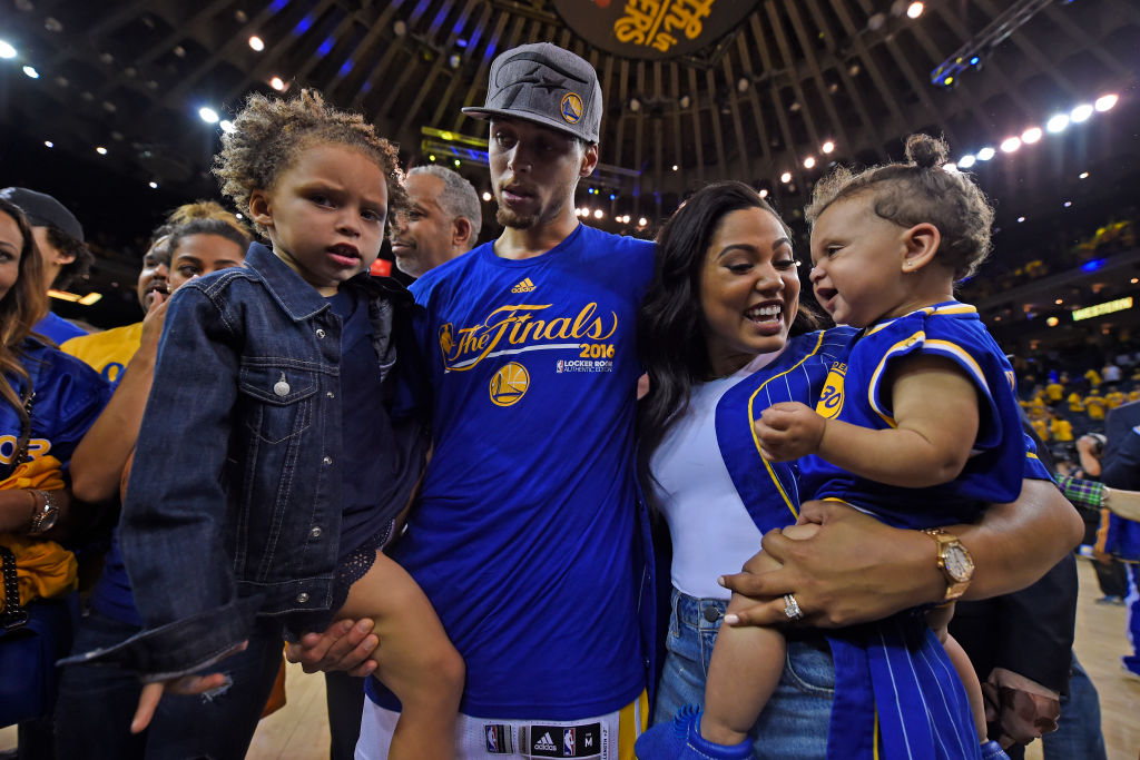 Warriors point guard Stephen Curry with his daughter Riley, wife Ayesha Curry, and daughter Ryan in 2016