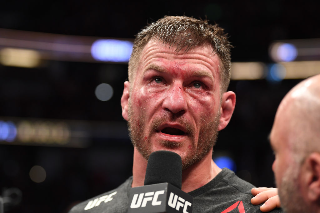 Stipe Miocic is interviewed after his TKO victory over Daniel Cormier in their heavyweight championship bout during the UFC 241 in 2019