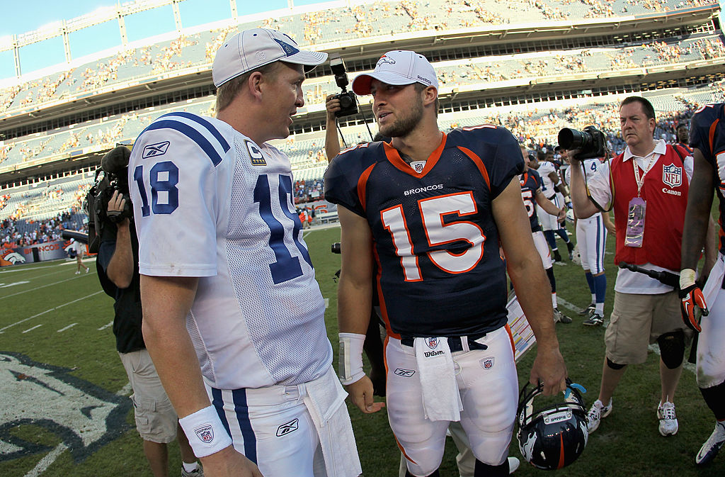Peyton Manning for the Indianapolis Colts talks to Tim Tebow for the Denver Broncos.