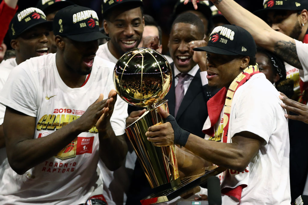 The Toronto Raptors celebrate with the Larry O'Brien Championship Trophy after their win