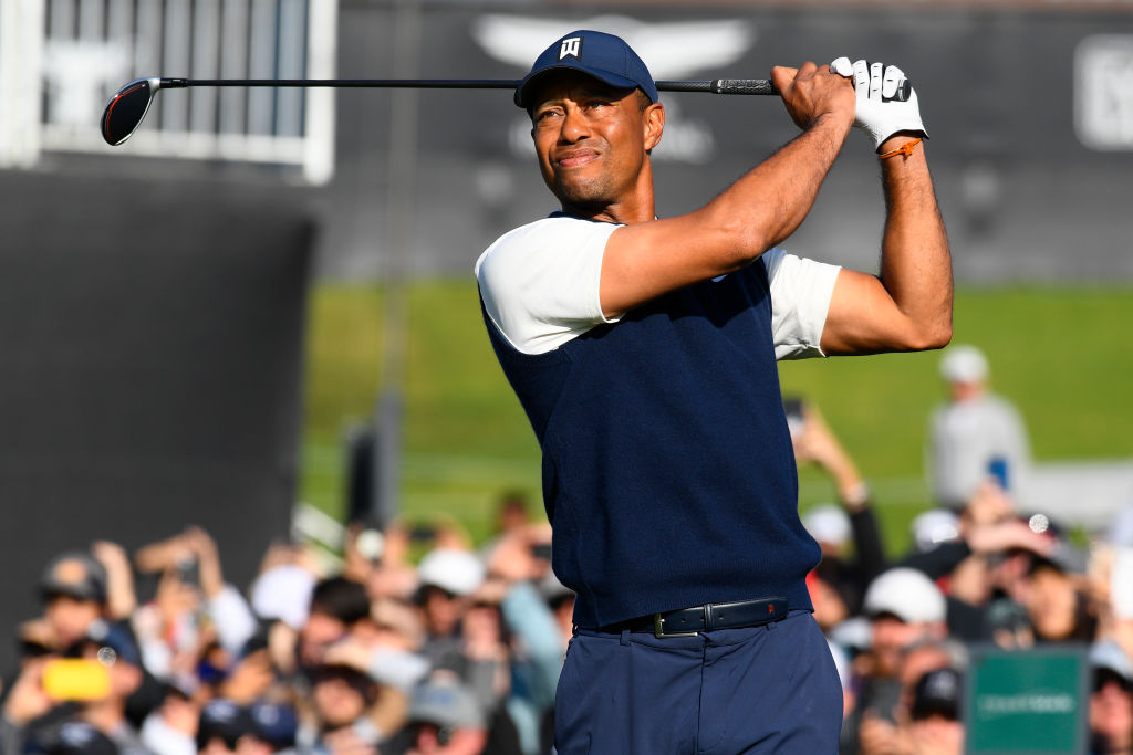 Tiger Woods drives the ball on the 9th hole tee during the Genesis Genesis Invitational golf tournament in 2020