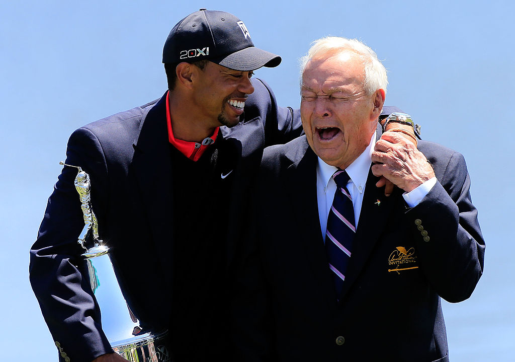 Tiger Woods and Arnold Palmer laugh during the ceremony following the 2013 Arnold Palmer Invitational