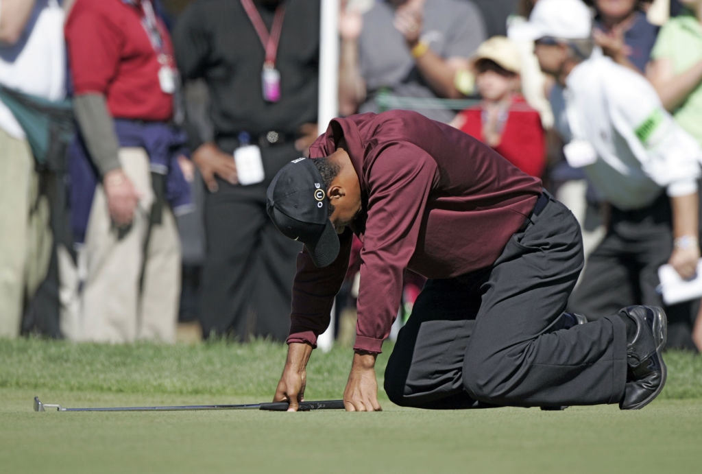 Tiger Woods showing frustration after missing a put