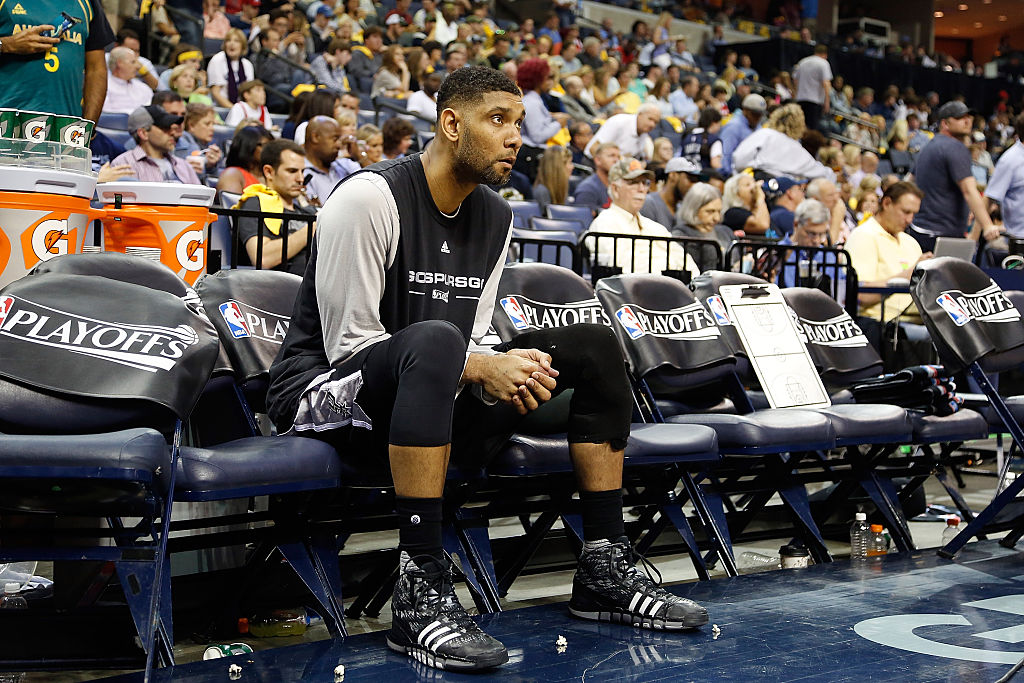 Tim Duncan of the San Antonio Spurs sits on the bench in 2016