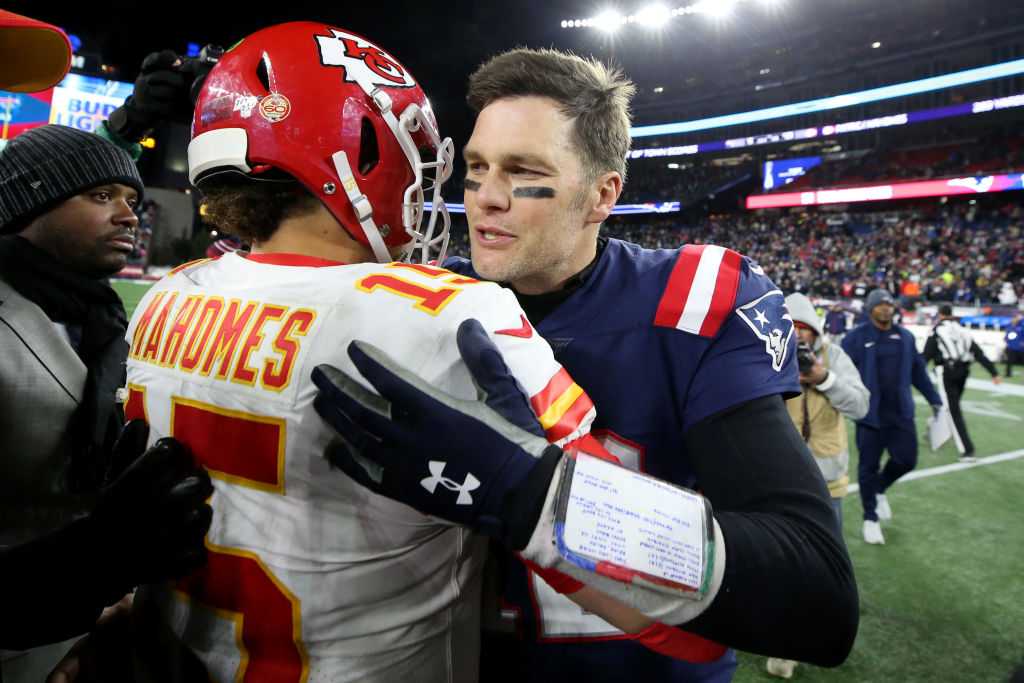 Tom Brady and Patrick Mahomes talk after a game