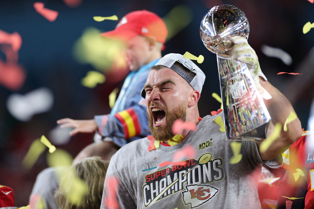 Travis Kelce of the Kansas City Chiefs celebrates with the Vince Lombardi Trophy after winning Super Bowl LIV