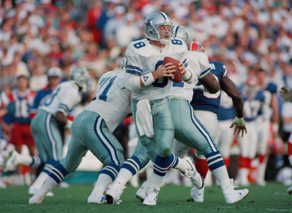 Former NFL quarterback Troy Aikman drops back for the Dallas Cowboys. Aikman won three Super Bowls after a bad rookie season.