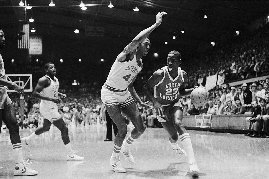 University of North Carolina guard Michael Jordan dribbles past a North Carolina State defender