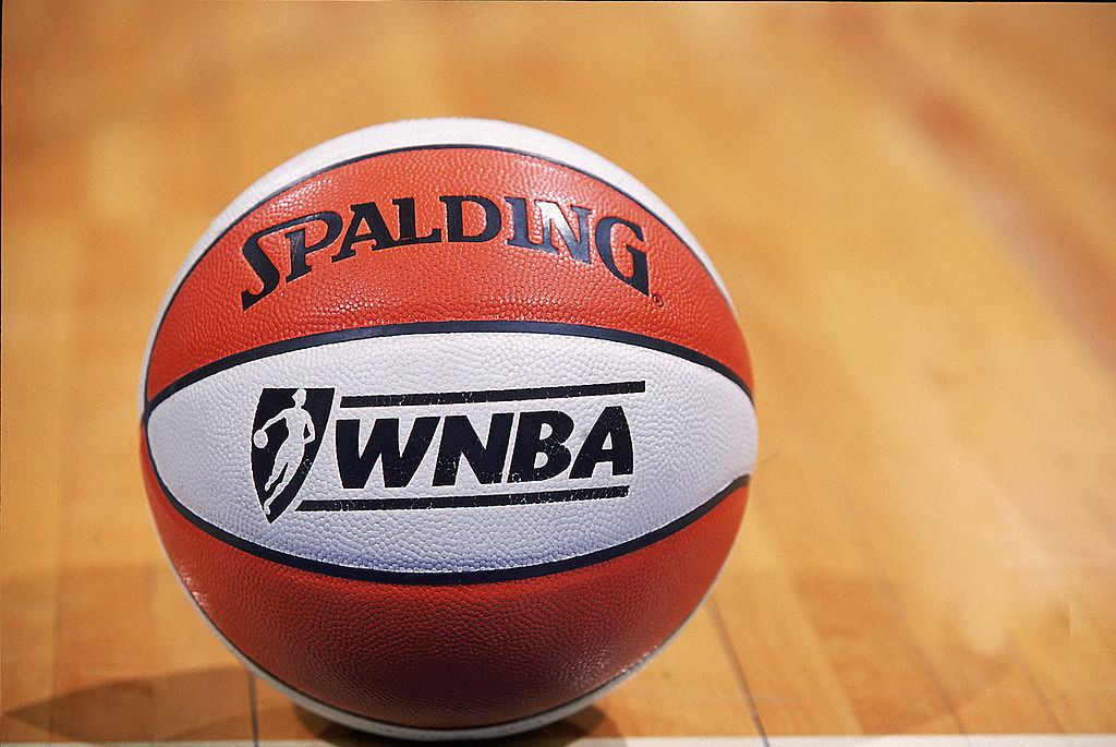 An official WNBA game ball on the court