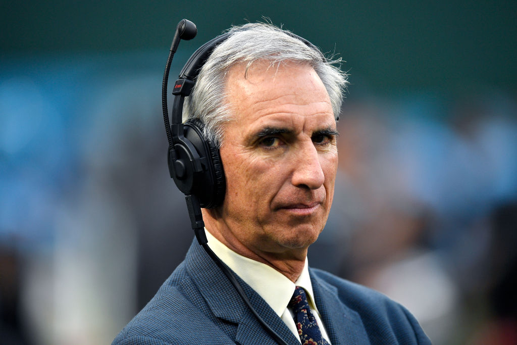 XFL Commissioner Oliver Luck with a microphone