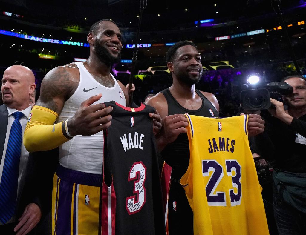 LeBron James and Dwyane Wade exchange jerseys.